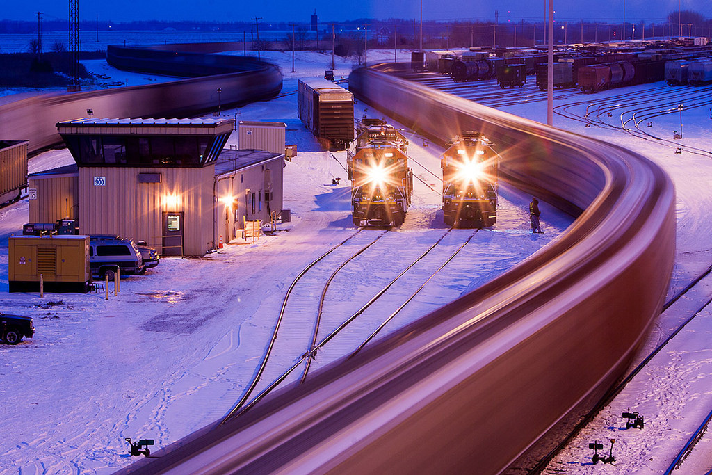 Nick Suydam by Center for Railroad Photography & Art Via Flickr: The BNSF yard in Galesburg, IL provides the scene for a departing train on a crisp winter night.